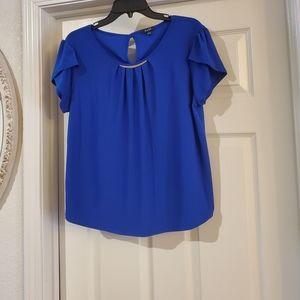 A.U.W ladies blouse is size Large